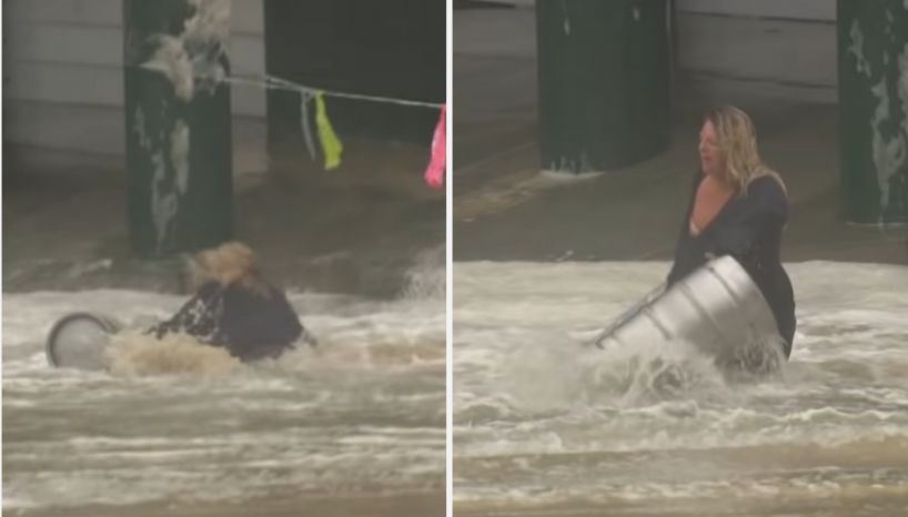 WATCH: Australian Woman Risks Her Life By Jumping Into Floodwater To Save Her Beer Kegs